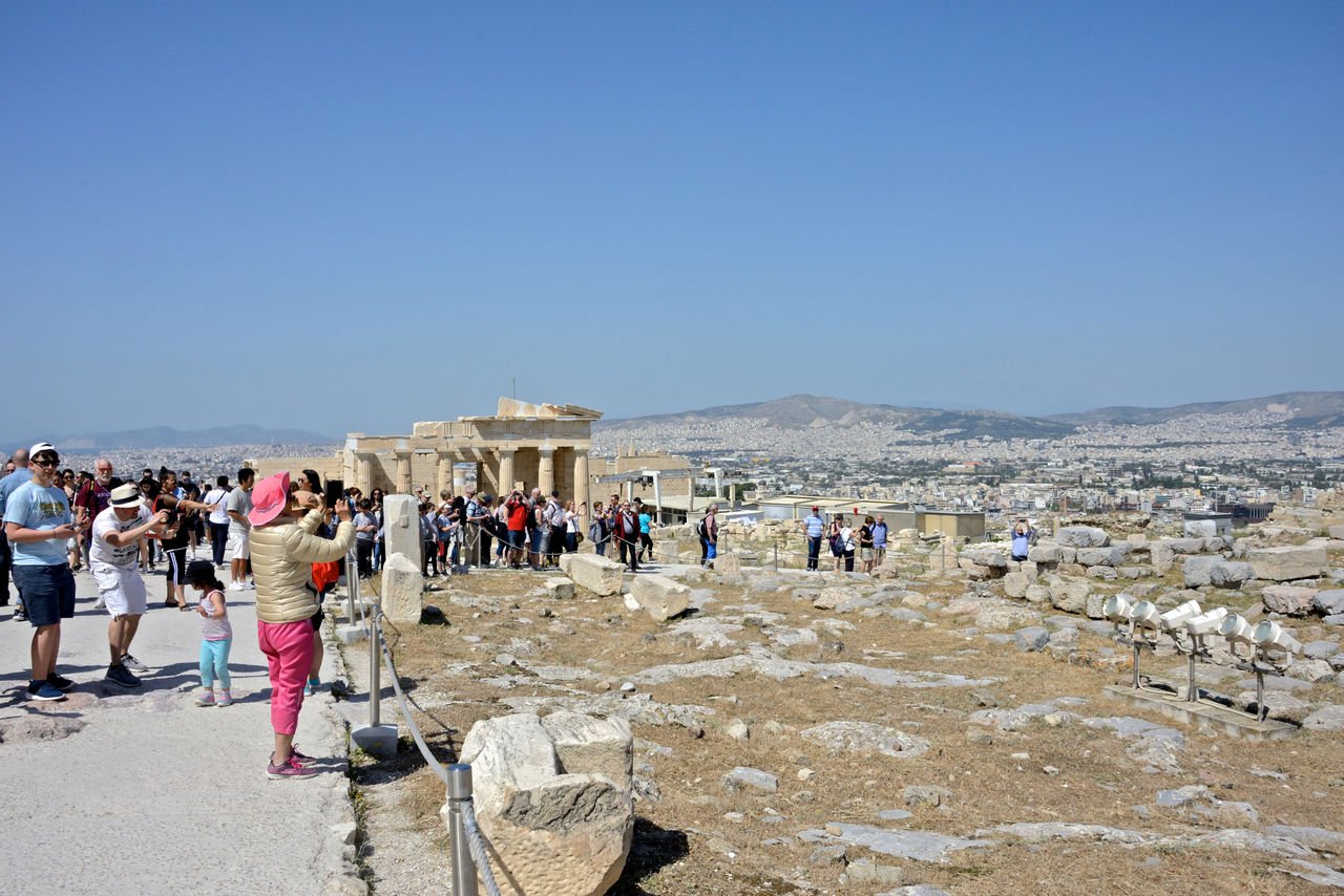 group of people, real people, crowd, large group of people, tourism, architecture, history, travel, travel destinations, the past, women, men, tourist, sky, copy space, built structure, clear sky, leisure activity, day, outdoors, ancient civilization, visit, archaeology