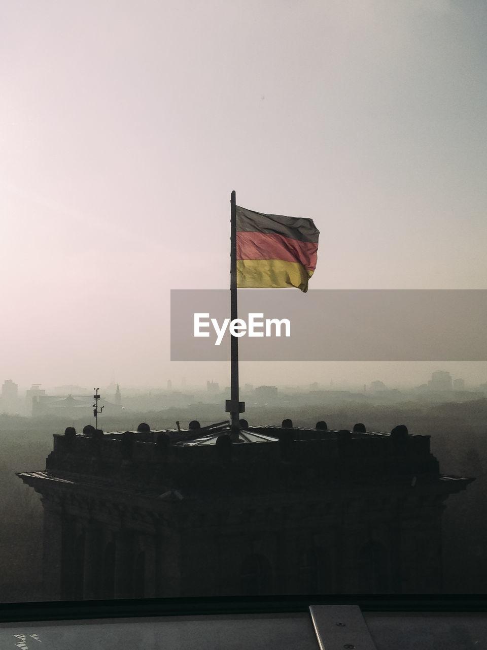 FLAGS AGAINST CLEAR SKY