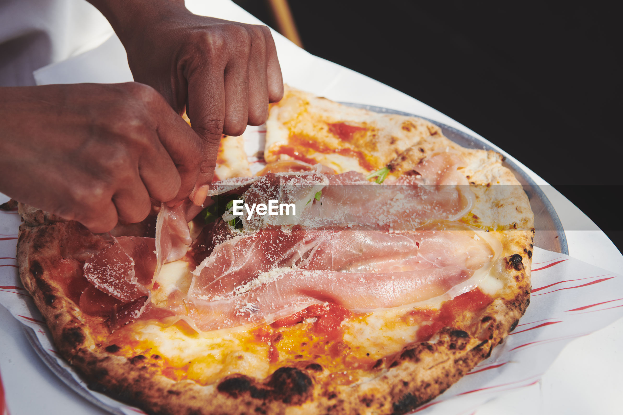 food, food and drink, dish, freshness, cuisine, fast food, hand, meat, pizza, meal, one person, indoors, plate, close-up, business, table, breakfast, unhealthy eating, slice