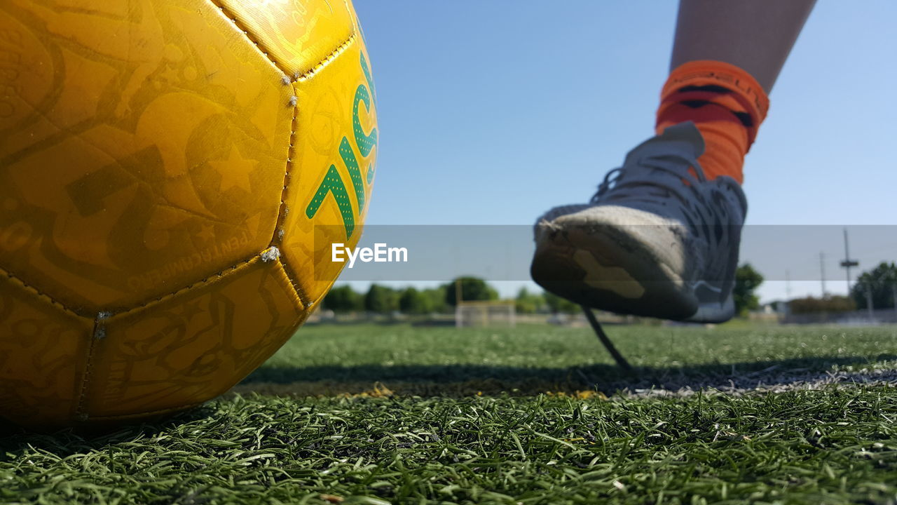 sport, shoe, human leg, low section, body part, human body part, one person, ball, grass, human foot, day, real people, leisure activity, lifestyles, sports equipment, nature, men, close-up, unrecognizable person, human limb