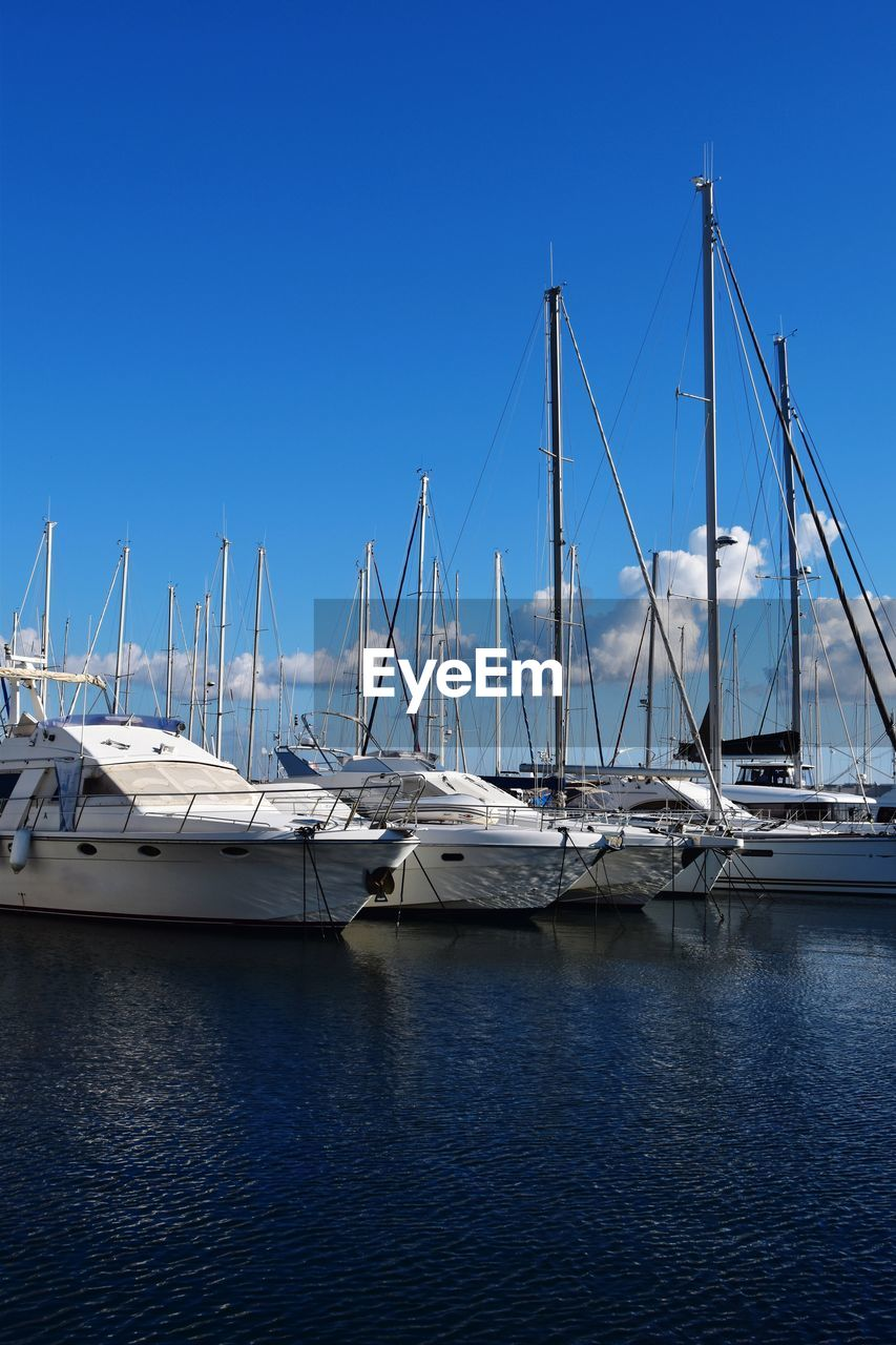 nautical vessel, transportation, mode of transportation, water, sky, sailboat, clear sky, blue, moored, harbor, nature, no people, day, mast, pole, sea, waterfront, yacht, outdoors, marina