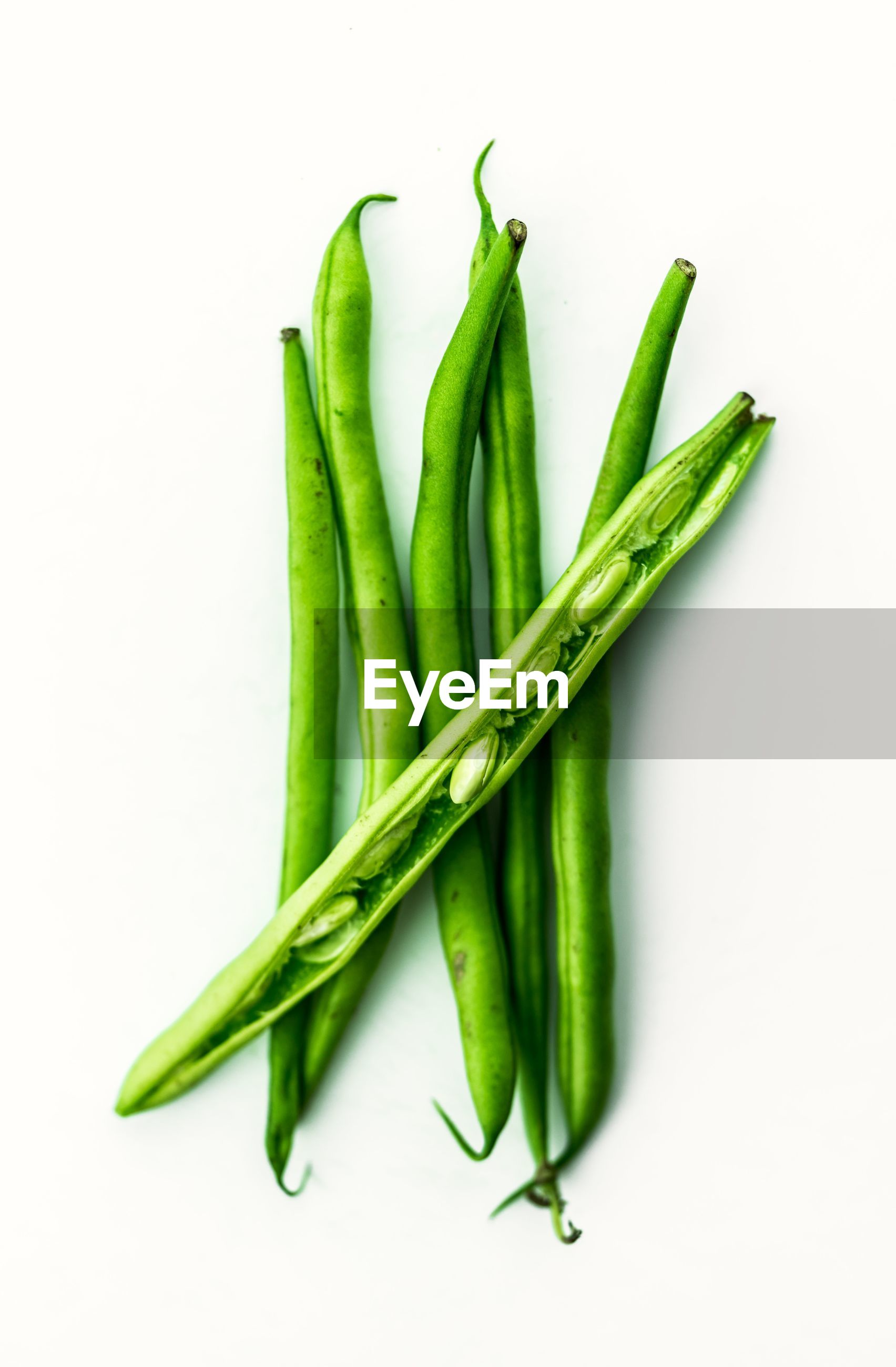 Close-up of green beans against white background