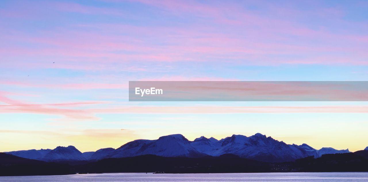 beauty in nature, scenics - nature, sky, mountain, tranquil scene, tranquility, sunset, water, cloud - sky, mountain range, waterfront, idyllic, nature, no people, non-urban scene, sea, blue, outdoors, mountain peak