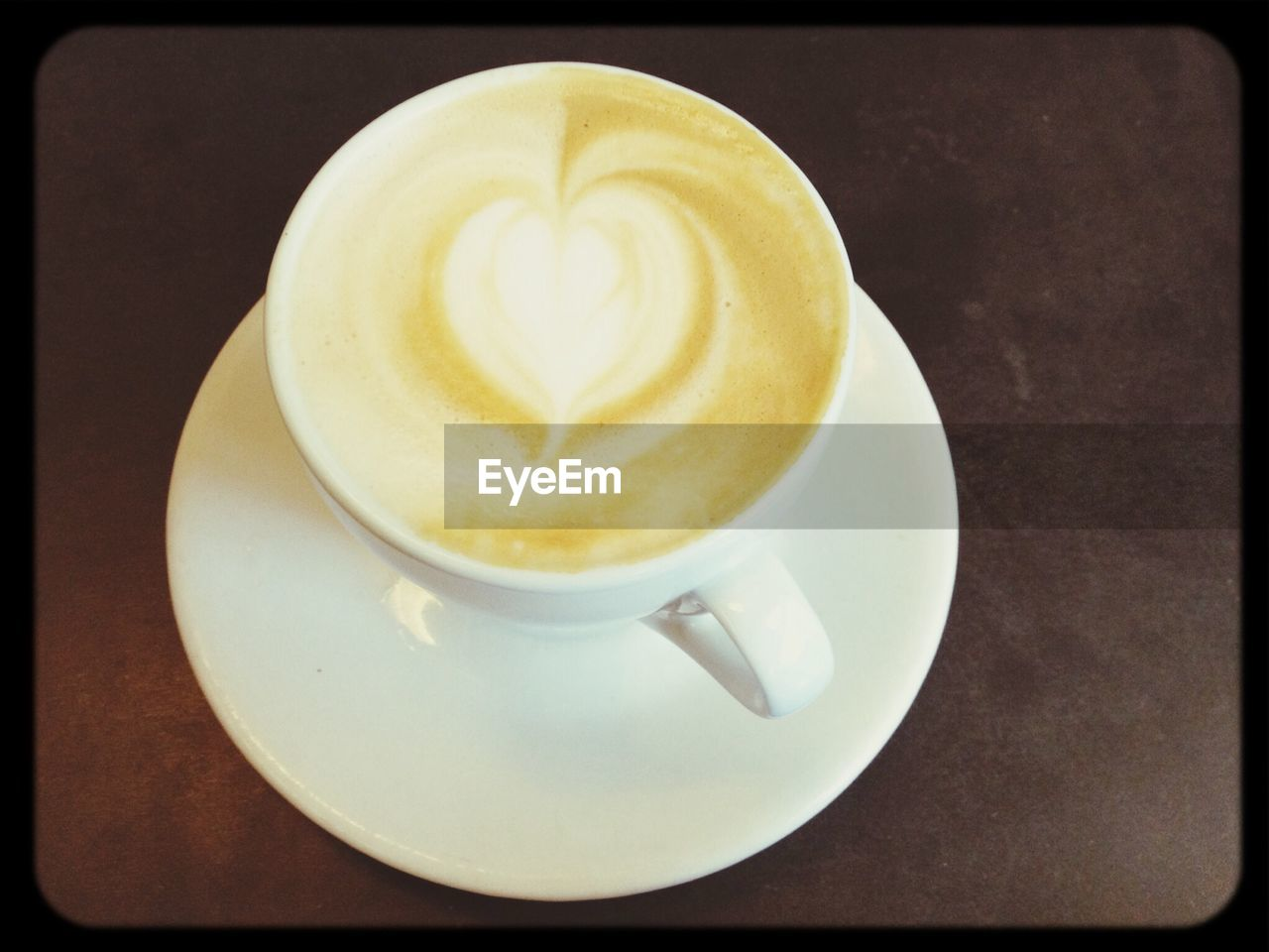 coffee cup, coffee - drink, drink, refreshment, saucer, frothy drink, cappuccino, food and drink, table, froth art, close-up, no people, freshness, indoors, latte