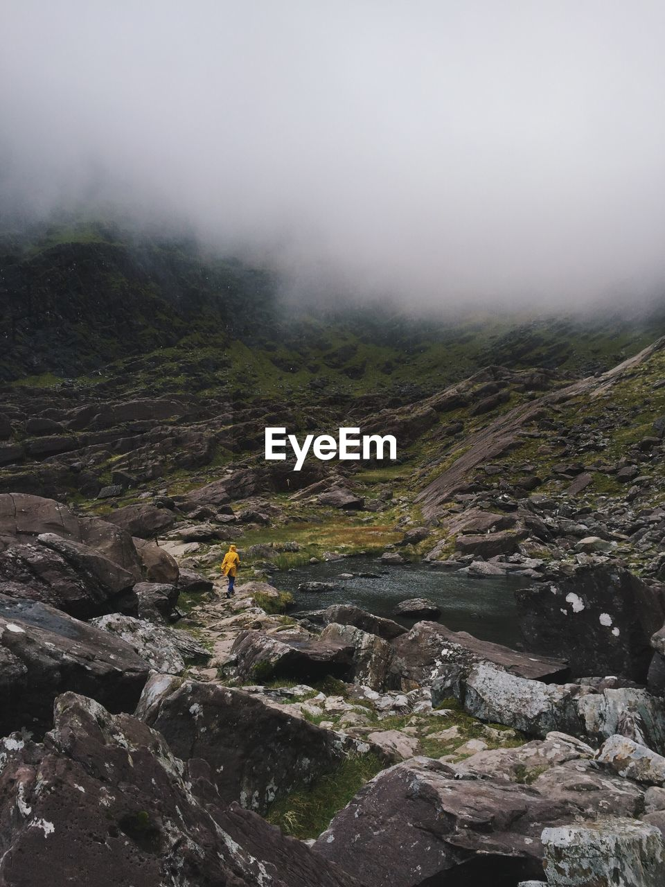 fog, landscape, adventure, mountain, nature, outdoors, scenics, tranquil scene, day, rock - object, one person, beauty in nature, real people, wilderness, tranquility, hiking, leisure activity, sky, challenge, full length, extreme sports, men, one man only, people