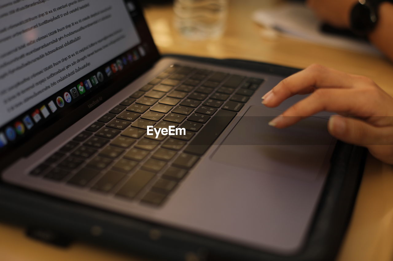 technology, computer, laptop, human hand, wireless technology, communication, human body part, one person, hand, real people, using laptop, portable information device, selective focus, connection, indoors, human finger, body part, keyboard, lifestyles, finger, typing, surfing the net