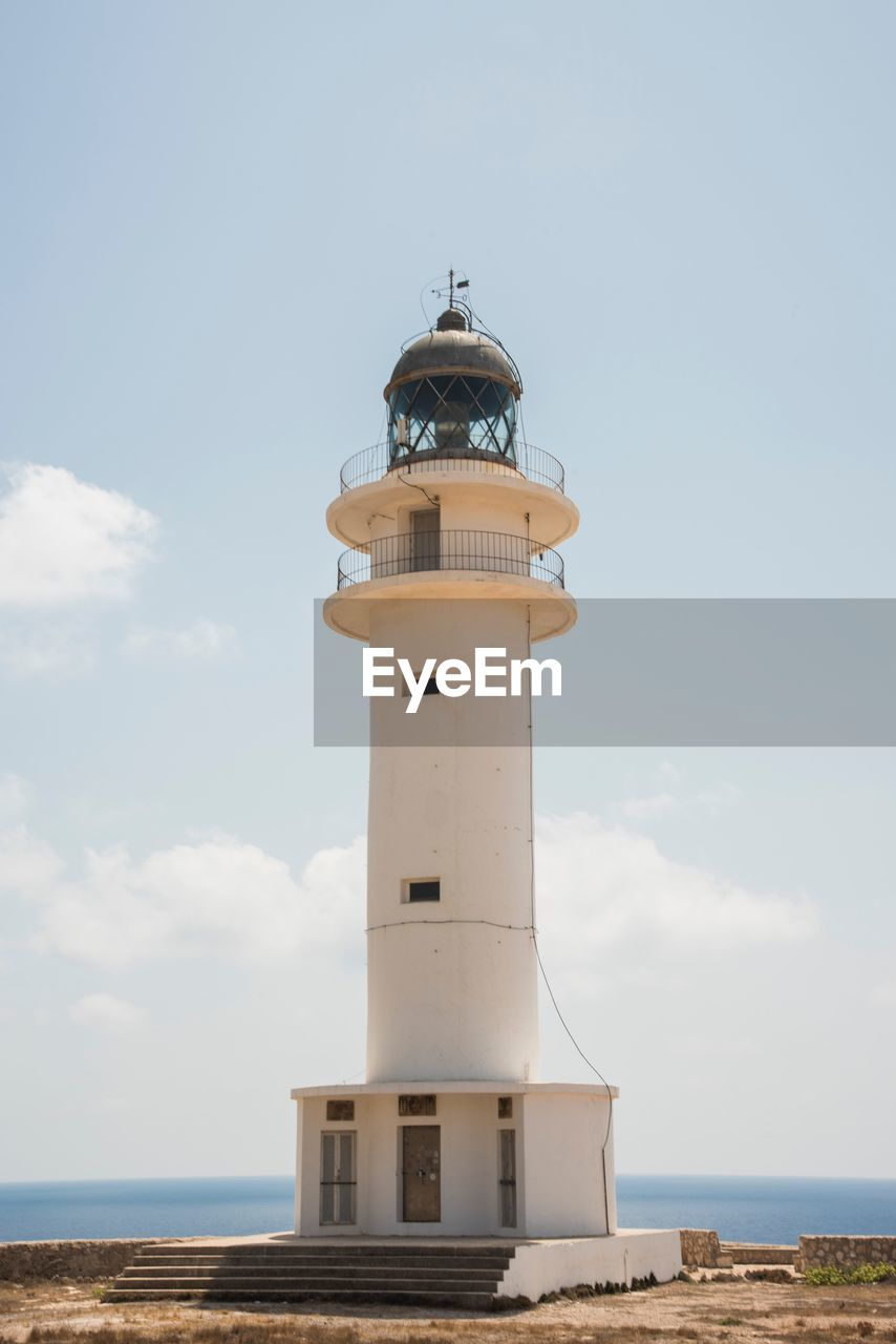 sky, tower, lighthouse, guidance, architecture, built structure, security, protection, safety, building exterior, sea, water, direction, nature, building, day, horizon over water, horizon, cloud - sky, no people, outdoors