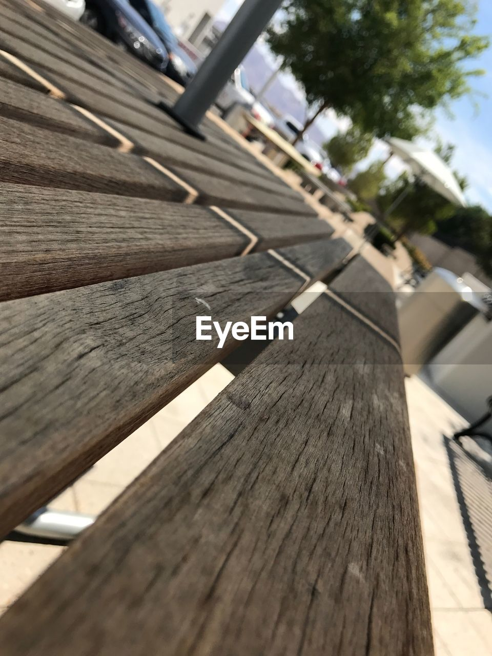 wood - material, plank, wood paneling, day, outdoors, focus on foreground, no people, built structure, sunlight, close-up, tree, architecture, building exterior, nature, sky