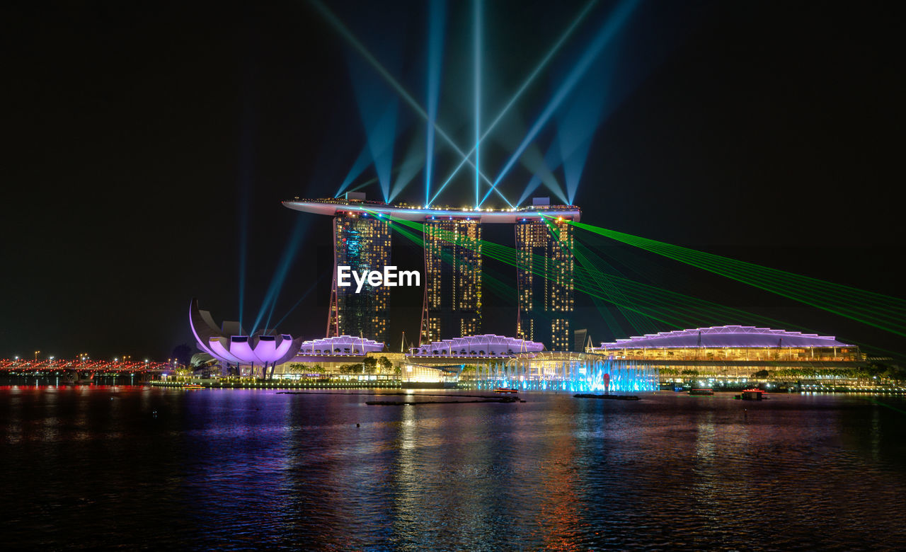 Illuminated Marina Bay Sands By Sea Against Sky