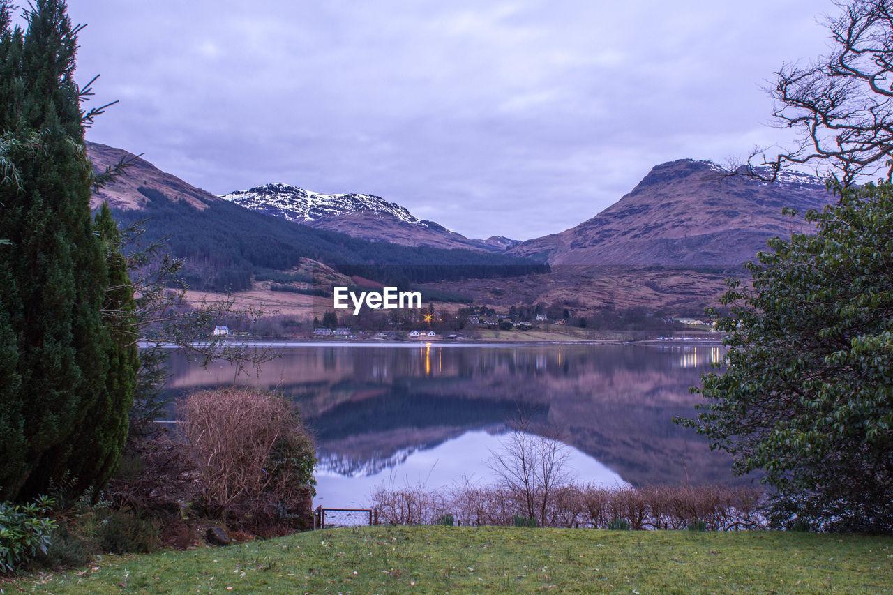 Scenic reflection of rocky landscape in lake