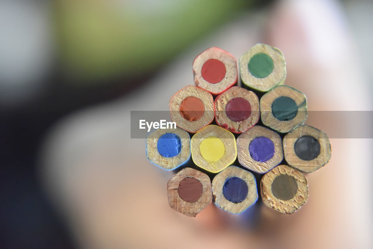 multi colored, close-up, art and craft, choice, selective focus, still life, variation, no people, shape, indoors, design, creativity, geometric shape, circle, focus on foreground, table, craft, high angle view, art and craft equipment, colored pencil, personal accessory