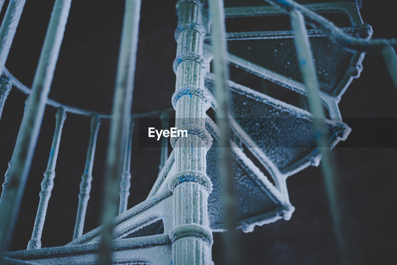Low Angle View Of Frozen Spiral Staircase During Winter At Night