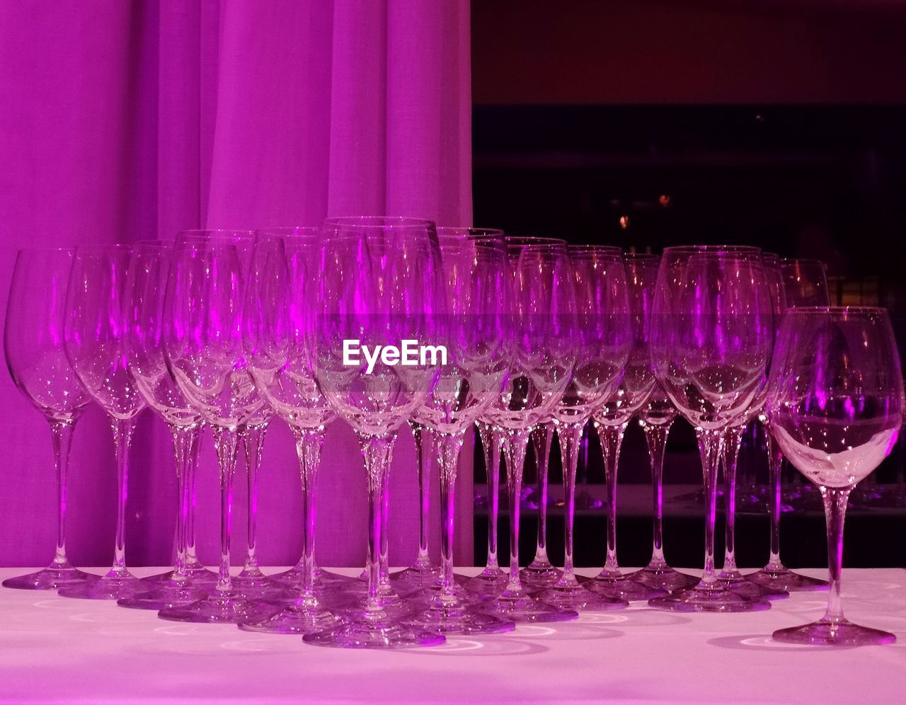glass, pink color, purple, food and drink, refreshment, drink, no people, indoors, glass - material, table, alcohol, still life, household equipment, drinking glass, close-up, illuminated, night, bottle, transparent, nightlife, bar counter