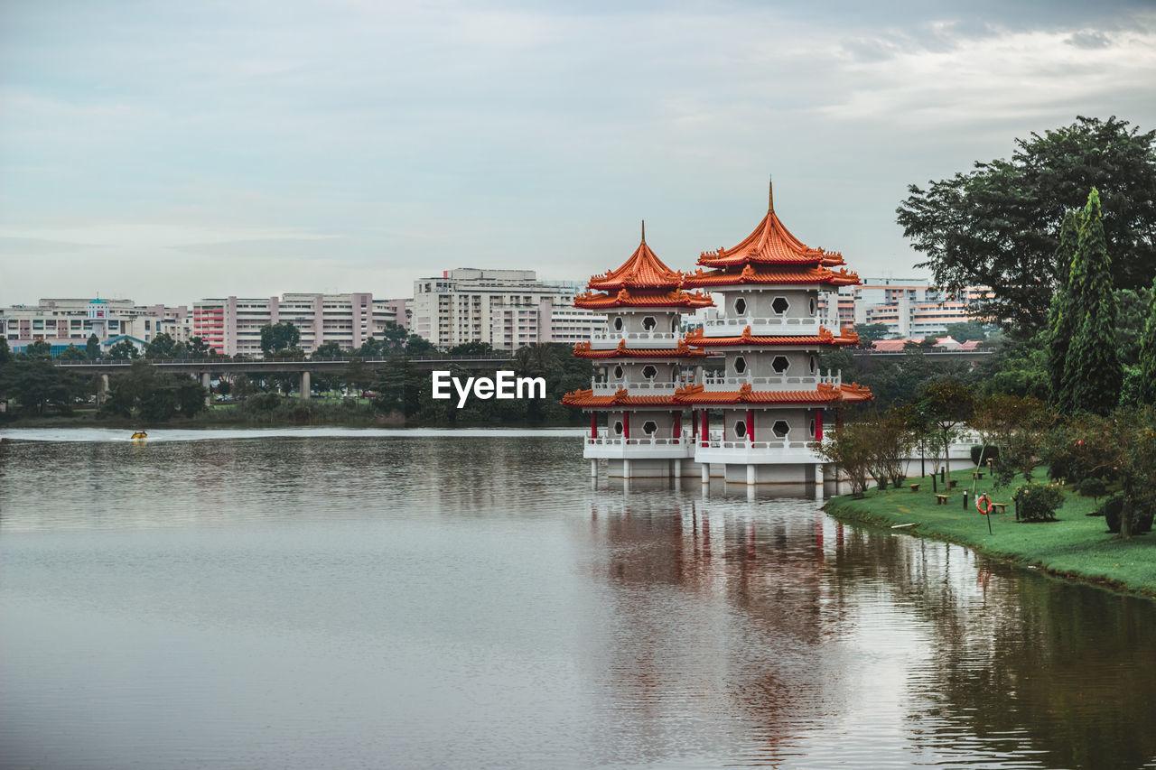 VIEW OF LAKE BY BUILDINGS AGAINST SKY