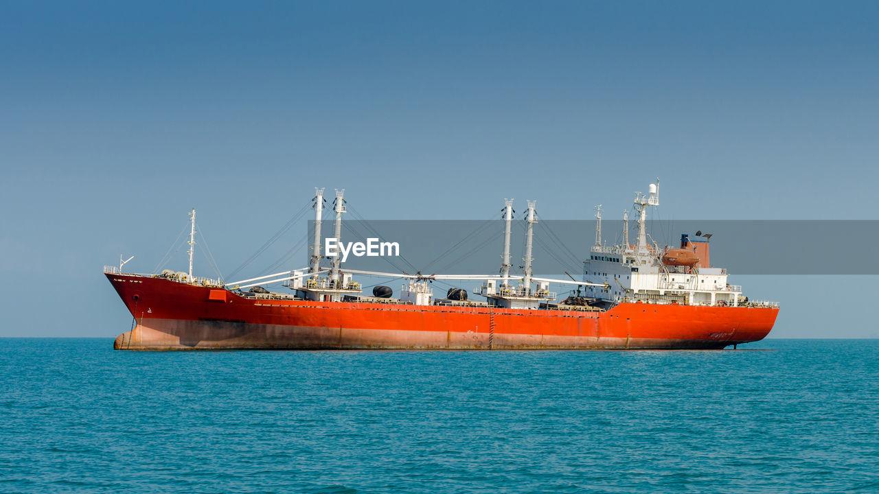 SHIP ON SEA AGAINST CLEAR BLUE SKY