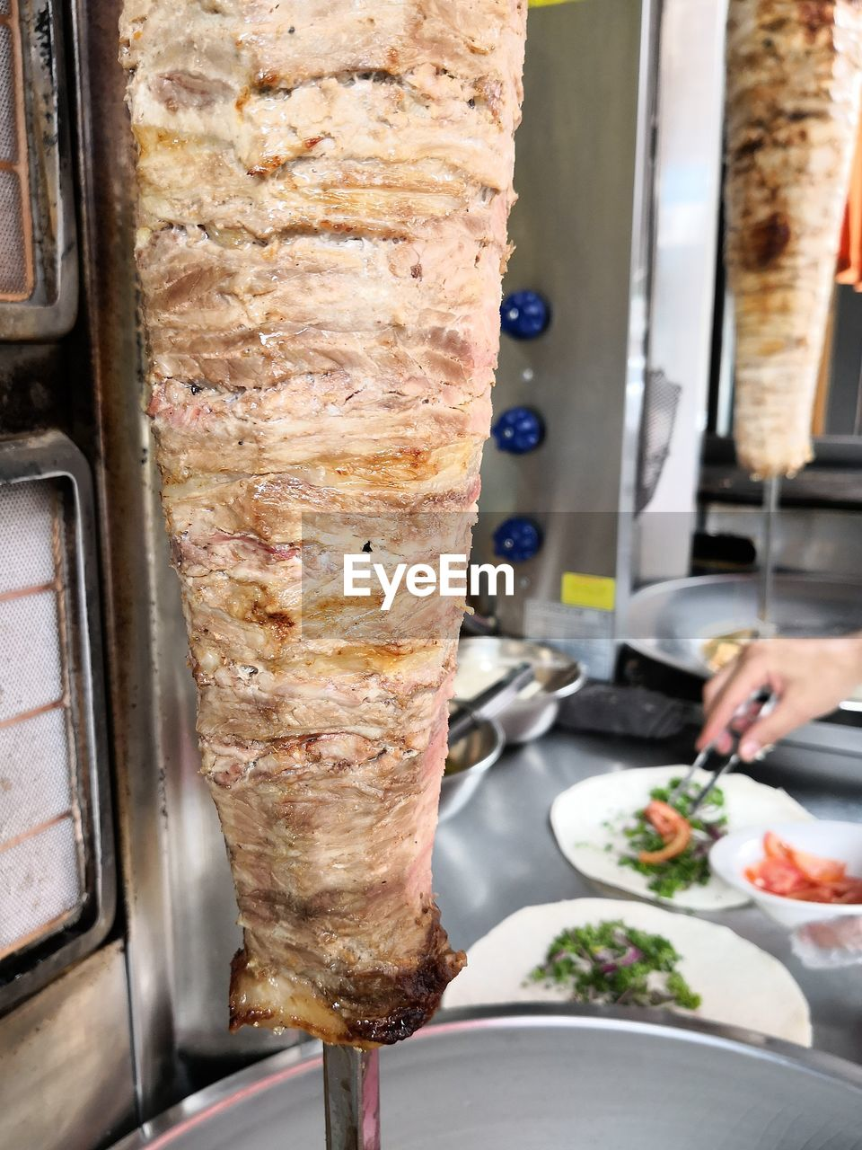 food, food and drink, human hand, preparation, freshness, preparing food, real people, human body part, one person, kitchen, indoors, healthy eating, commercial kitchen, close-up, ready-to-eat, food and drink establishment, day, people