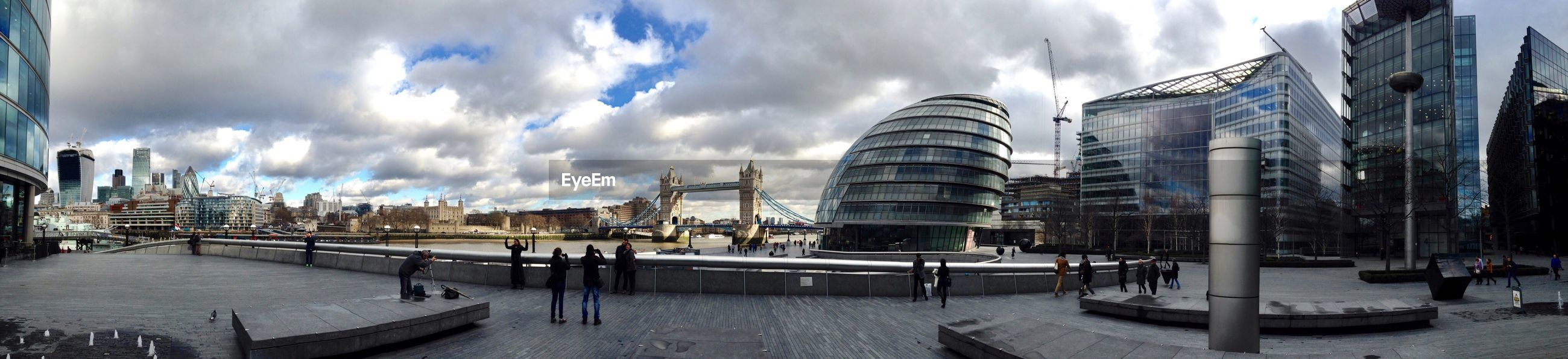 Panoramic view of london waterfront against cloudy sky