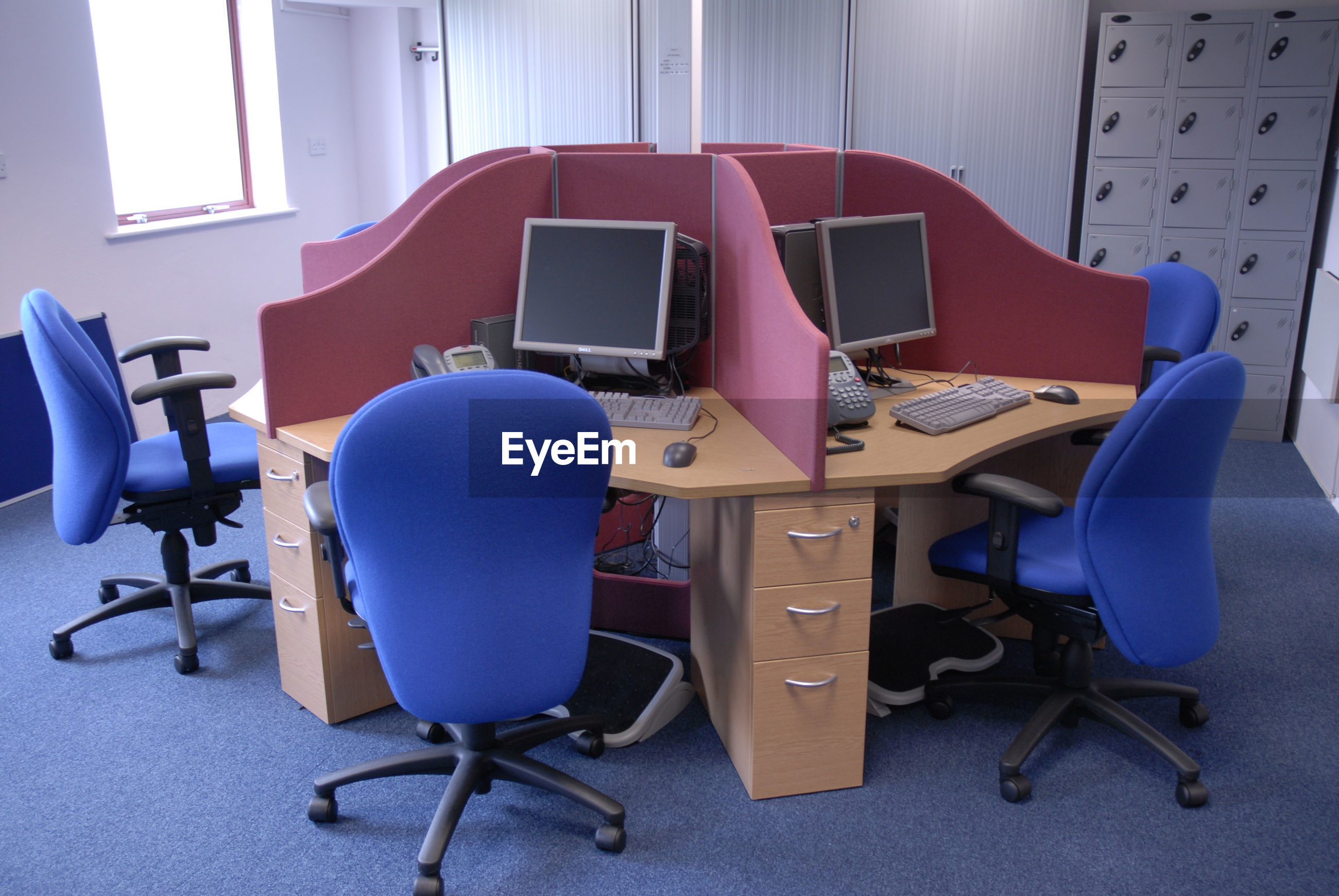 High angle view of chairs and computers in office