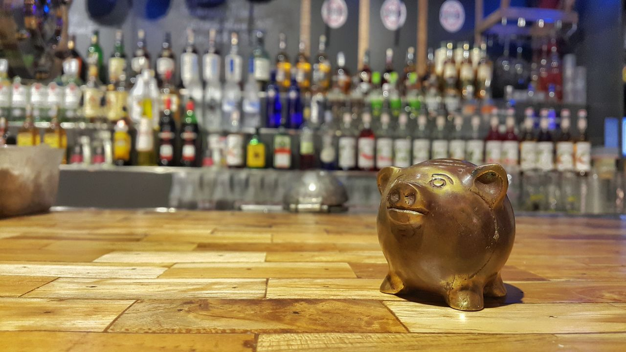 Piggy Bank On Table At Bar
