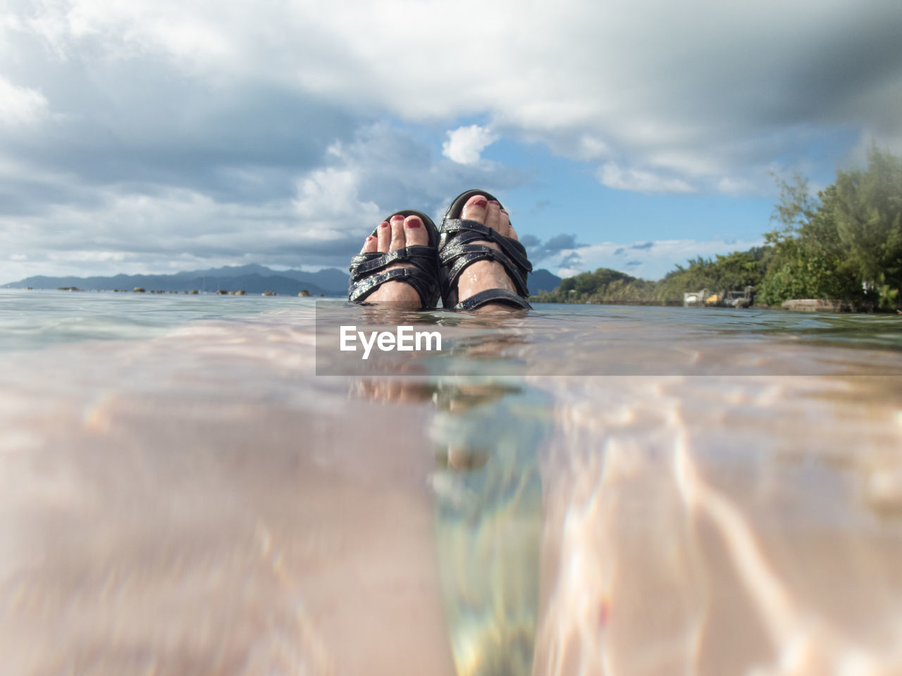 cloud - sky, low section, water, sky, human leg, day, nature, shoe, real people, outdoors, beauty in nature, one person, friendship, people