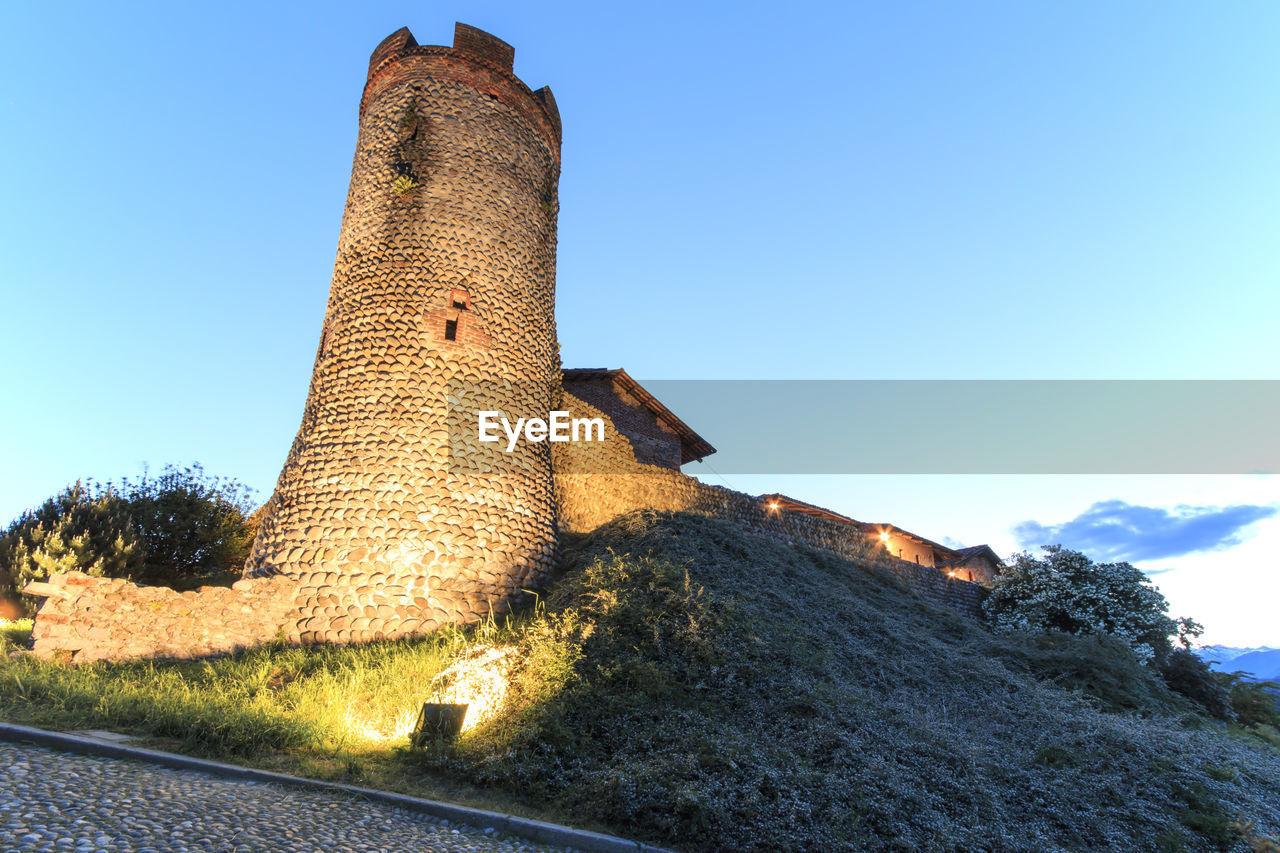 Historic Castle Against Sky In Candelo At Dusk