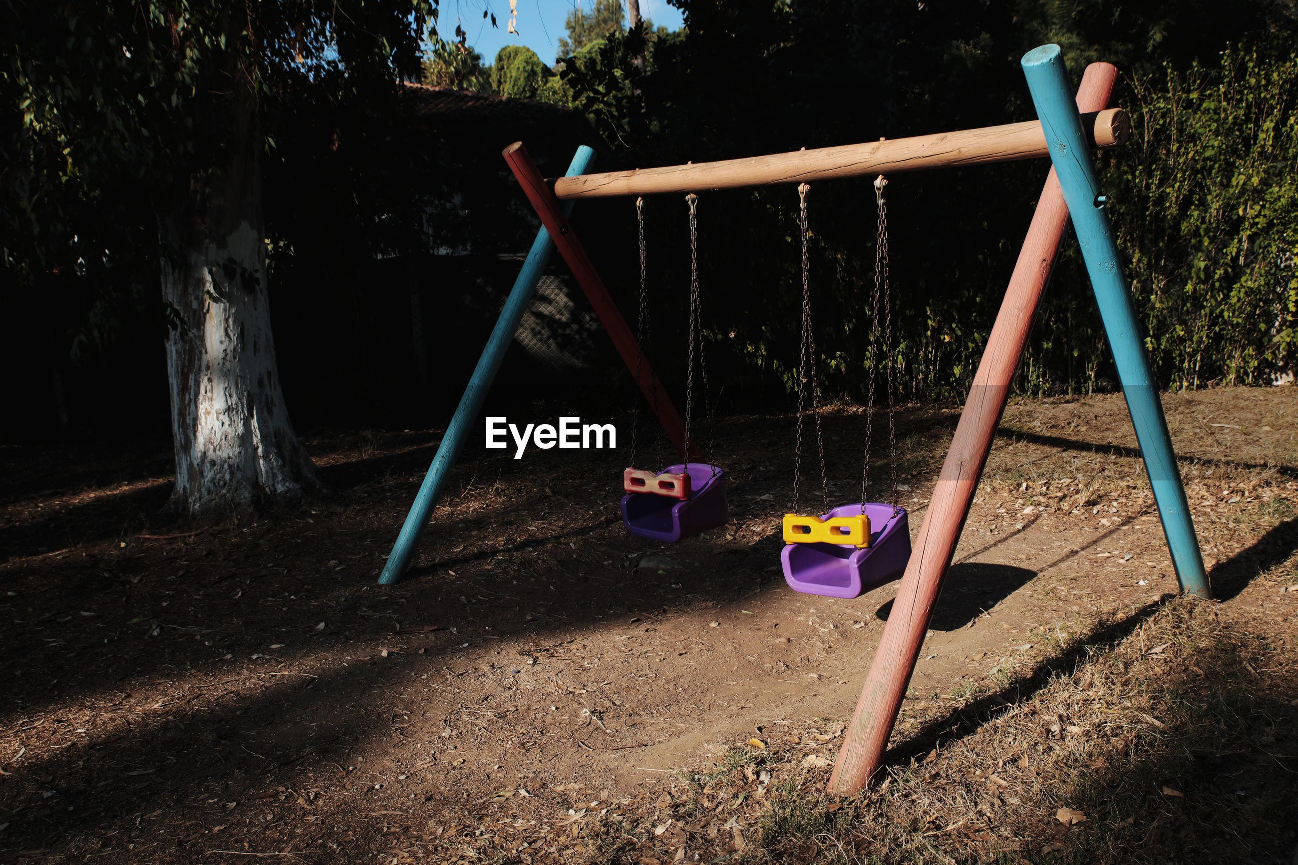View of empty swings in park