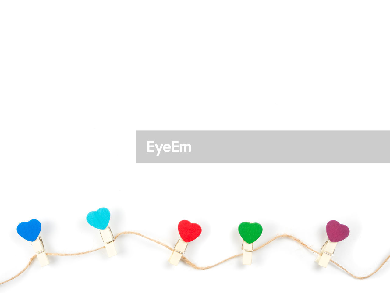 white background, studio shot, copy space, indoors, multi colored, no people, still life, close-up, connection, green color, red, string, white color, love, cut out, large group of objects, positive emotion, emotion, heart shape, cable