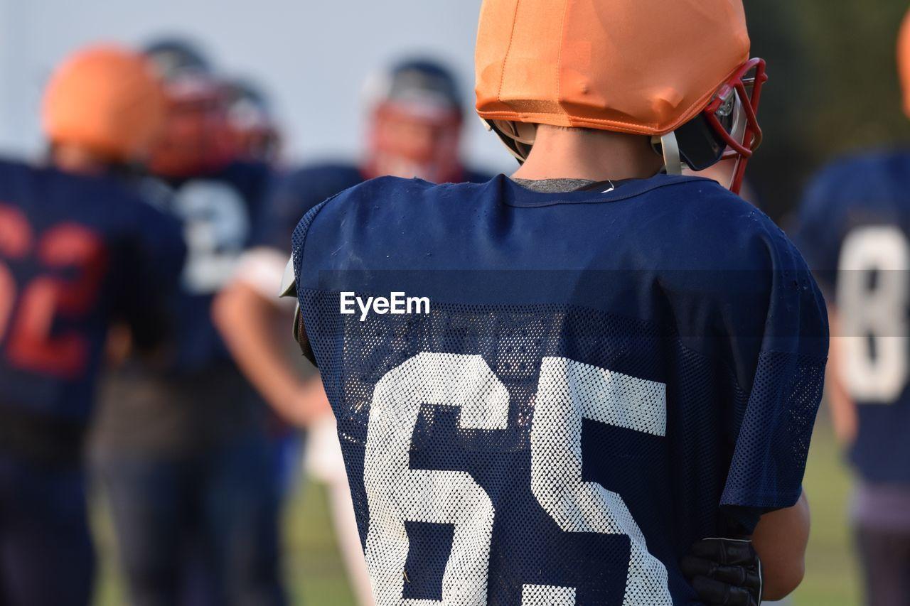 Rear view of man wearing sports uniform