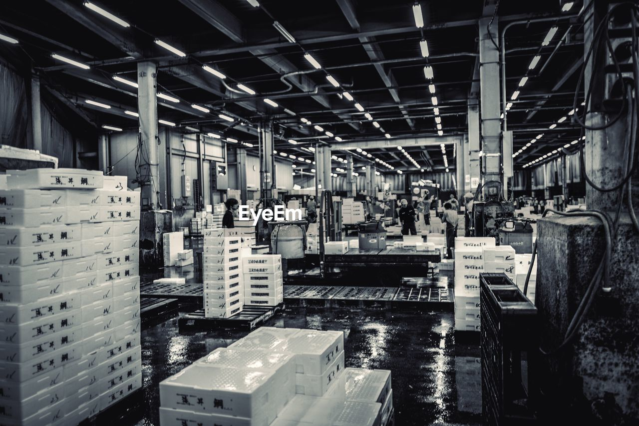 architecture, indoors, built structure, warehouse, factory, industry, domestic room, building, box, container, business, machinery, transportation, day, no people, box - container, roof, equipment, manufacturing equipment, industrial equipment, production line
