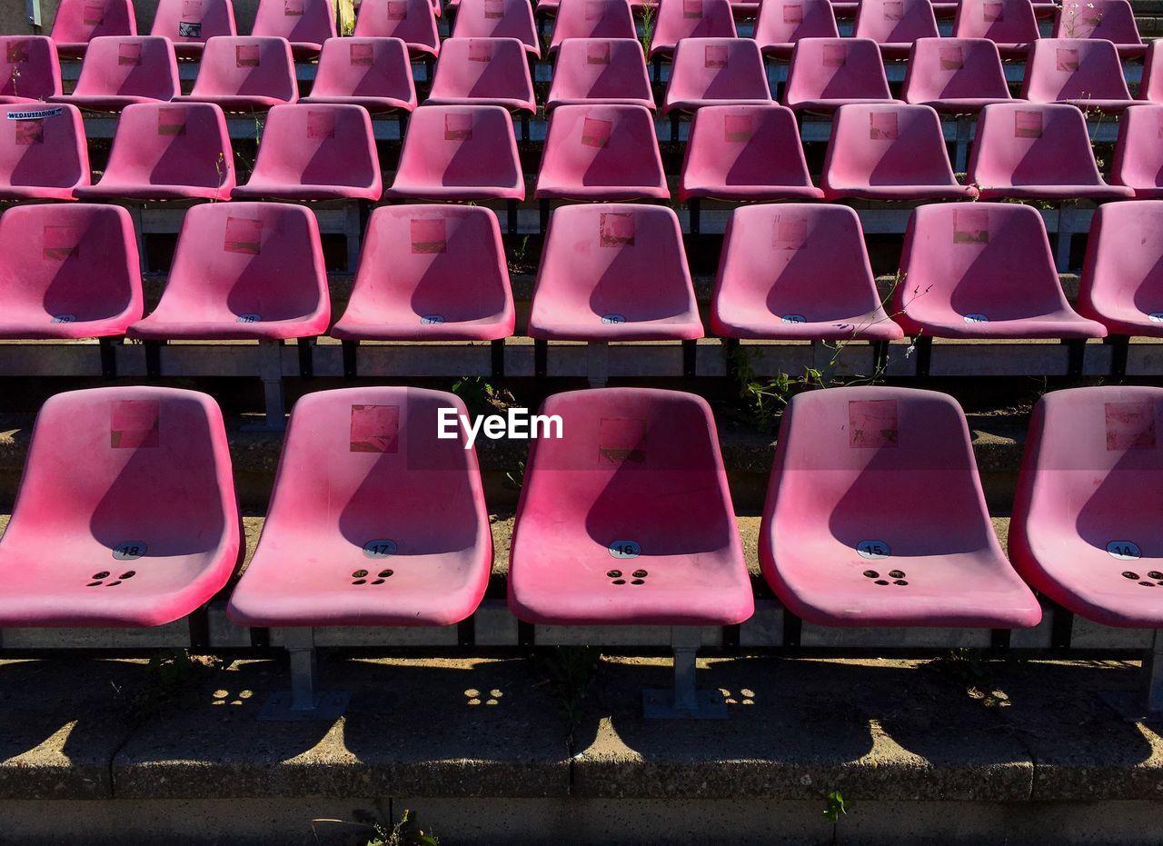 Empty Seats Of Bleachers In Stadium