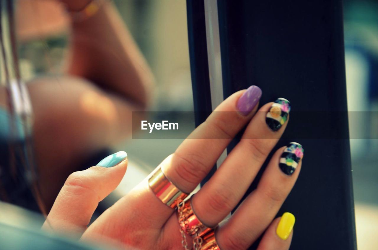 Cropped Image Of Fingers With Nail Art