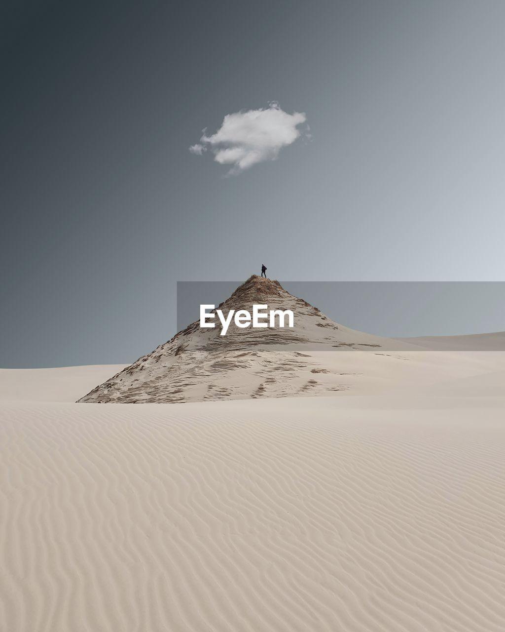 Sand dune at desert against sky