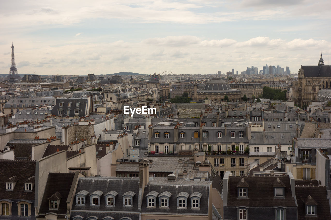 View Of Cityscape With Eiffel Tower In Distant