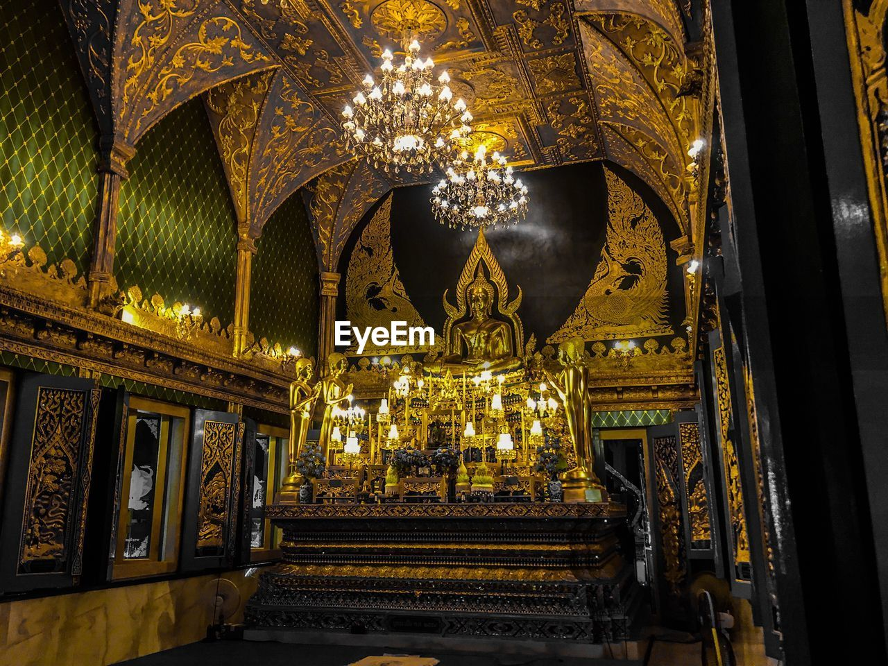 architecture, indoors, built structure, belief, building, place of worship, religion, spirituality, illuminated, lighting equipment, no people, gold colored, low angle view, chandelier, art and craft, ornate, representation, the past, ceiling, architectural column, altar