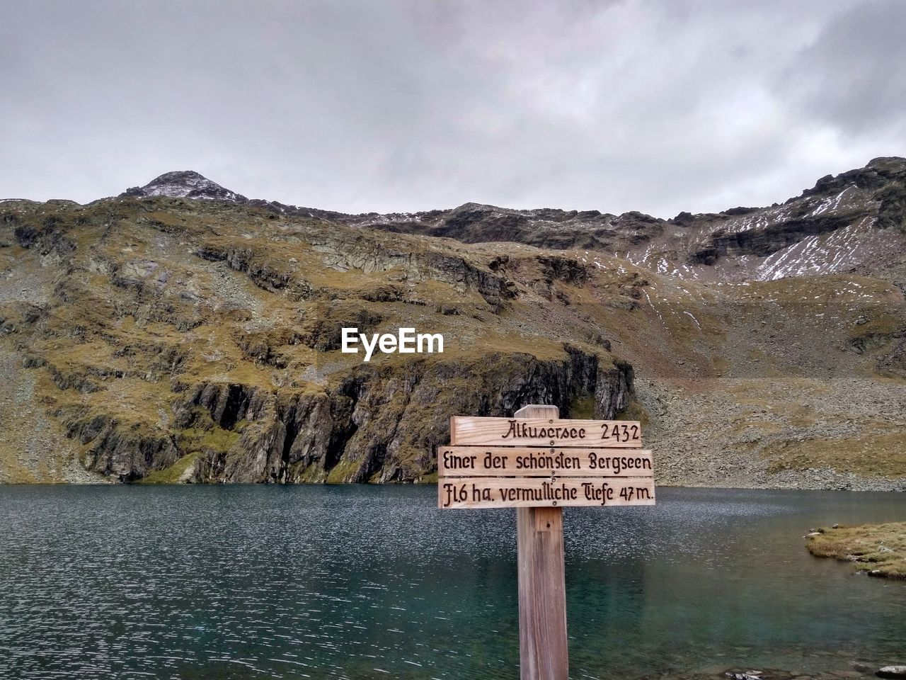 communication, text, sign, sky, western script, water, cloud - sky, no people, mountain, scenics - nature, nature, beauty in nature, tranquil scene, information, tranquility, information sign, non-urban scene, day, warning sign, guidance, formation