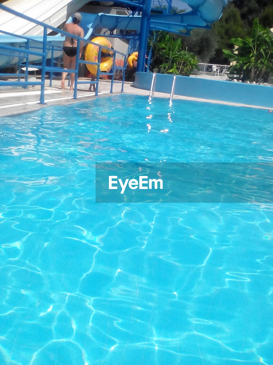 swimming pool, water, day, blue, waterfront, sunlight, outdoors, vacations, summer, real people, nature, one person, people