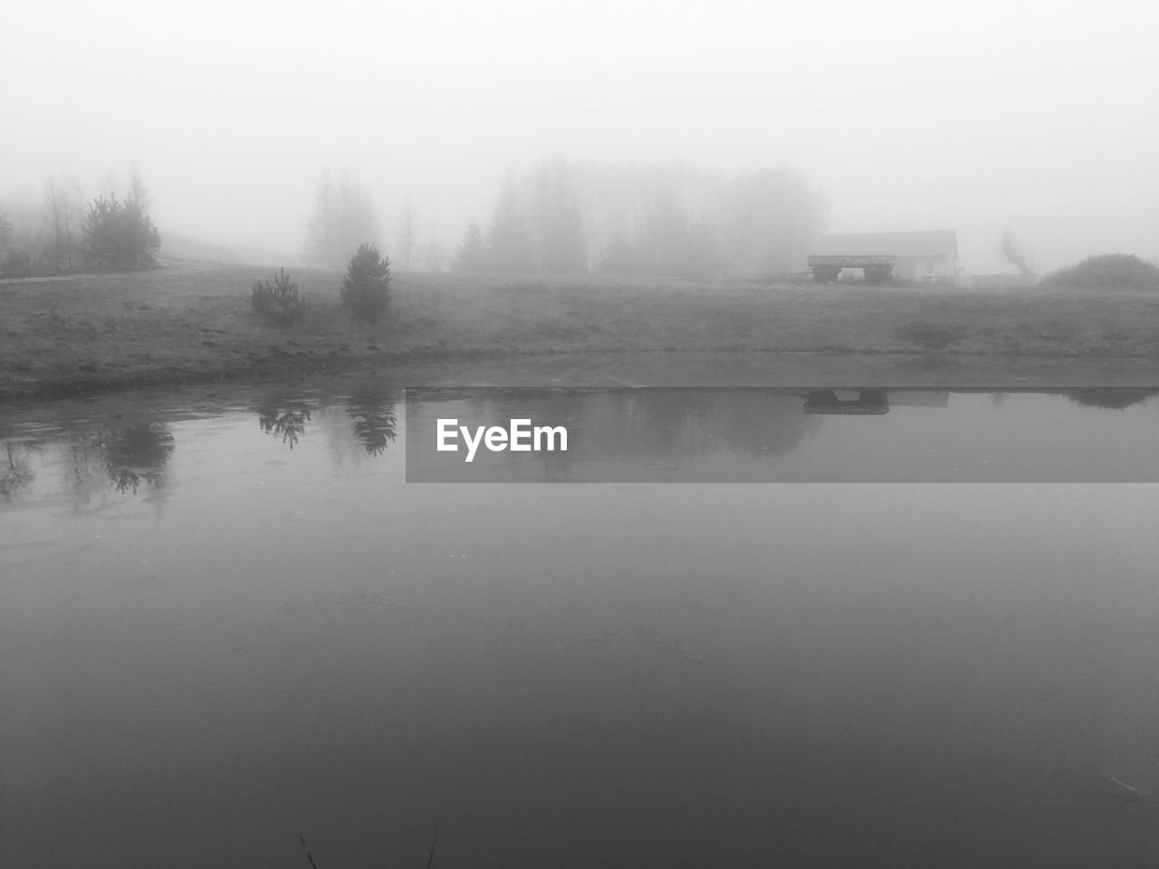 fog, foggy, mist, nature, tranquil scene, no people, weather, tranquility, water, reflection, outdoors, hazy, scenics, beauty in nature, tree, day, landscape, cold temperature, dawn, sky