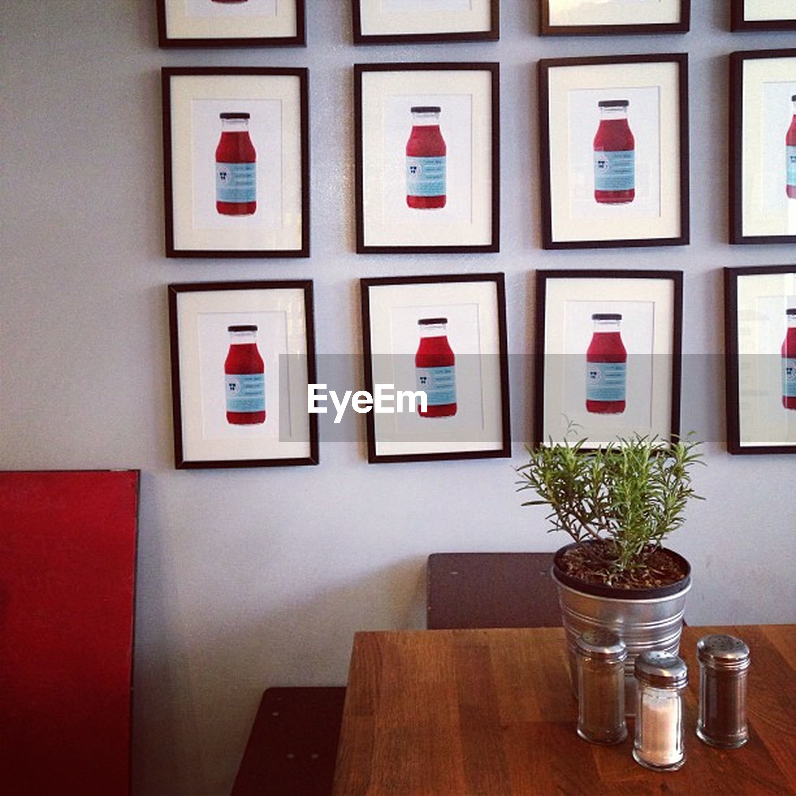 indoors, table, window, glass - material, still life, home interior, transparent, arrangement, no people, red, variation, multi colored, in a row, side by side, absence, empty, decoration, wall, shelf, glass