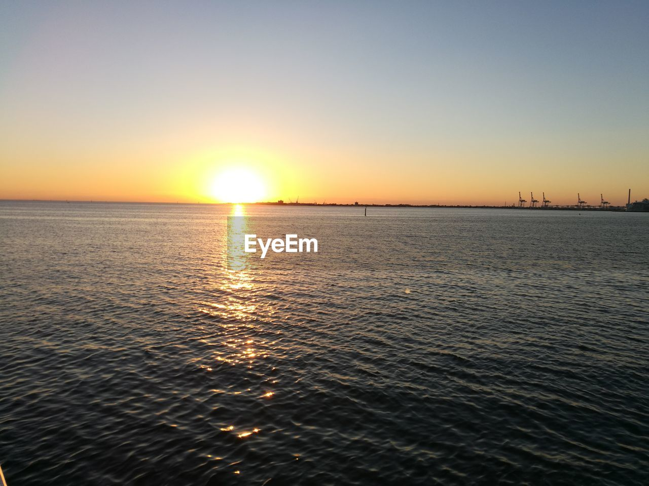 sunset, sun, sea, beauty in nature, scenics, nature, water, tranquil scene, tranquility, sunlight, idyllic, reflection, no people, sky, outdoors, clear sky, horizon over water, day