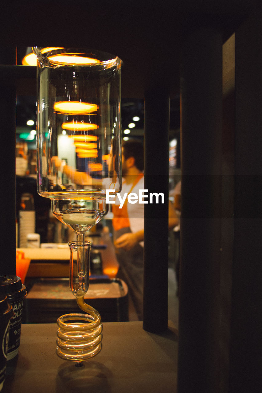 alcohol, food and drink, drink, alcoholic drink, refreshment, table, illuminated, indoors, no people, drinking glass, beer glass, freshness, bar - drink establishment, close-up, food and drink industry, night, wineglass