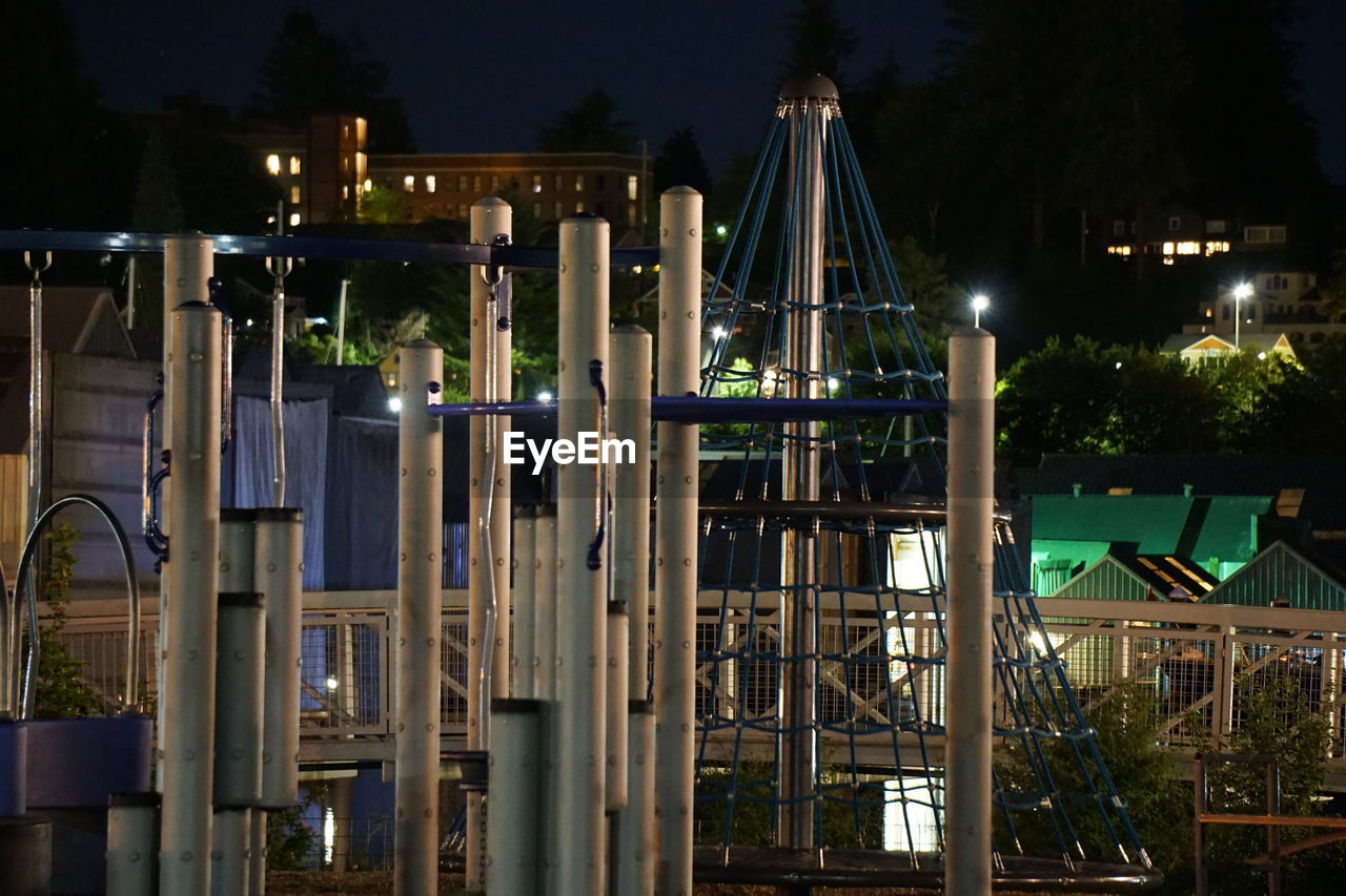 Play Equipment Against Houses At Night