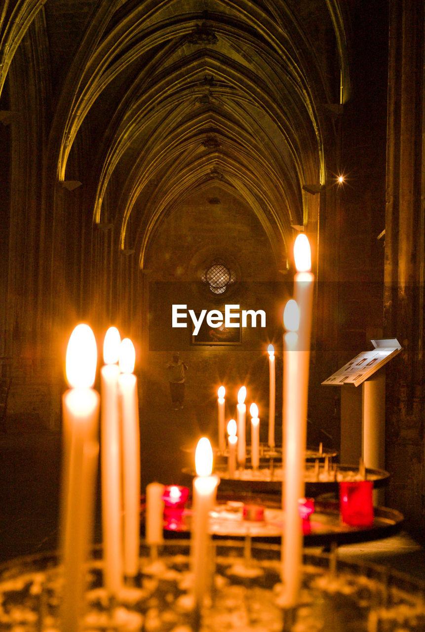 Illuminated candles in church