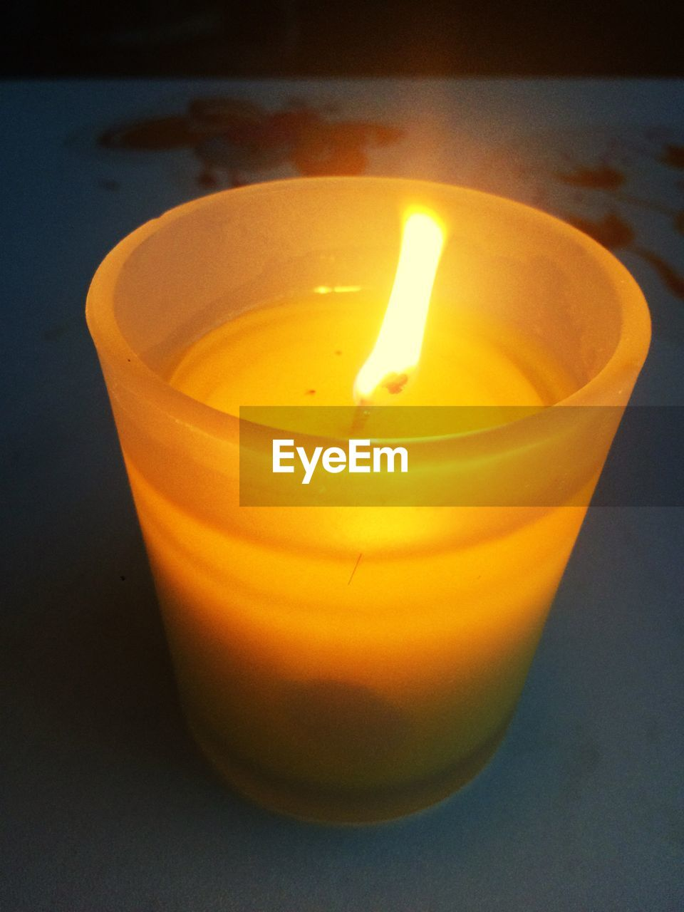Close-up of tea light candle burning on table