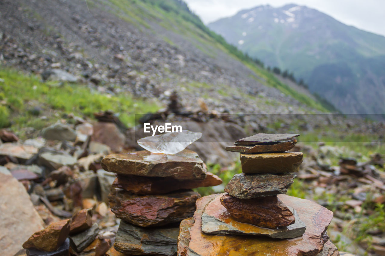 mountain, day, nature, no people, focus on foreground, stack, balance, solid, landscape, rock, metal, close-up, stone - object, outdoors, land, field, beauty in nature, environment, rock - object, tree
