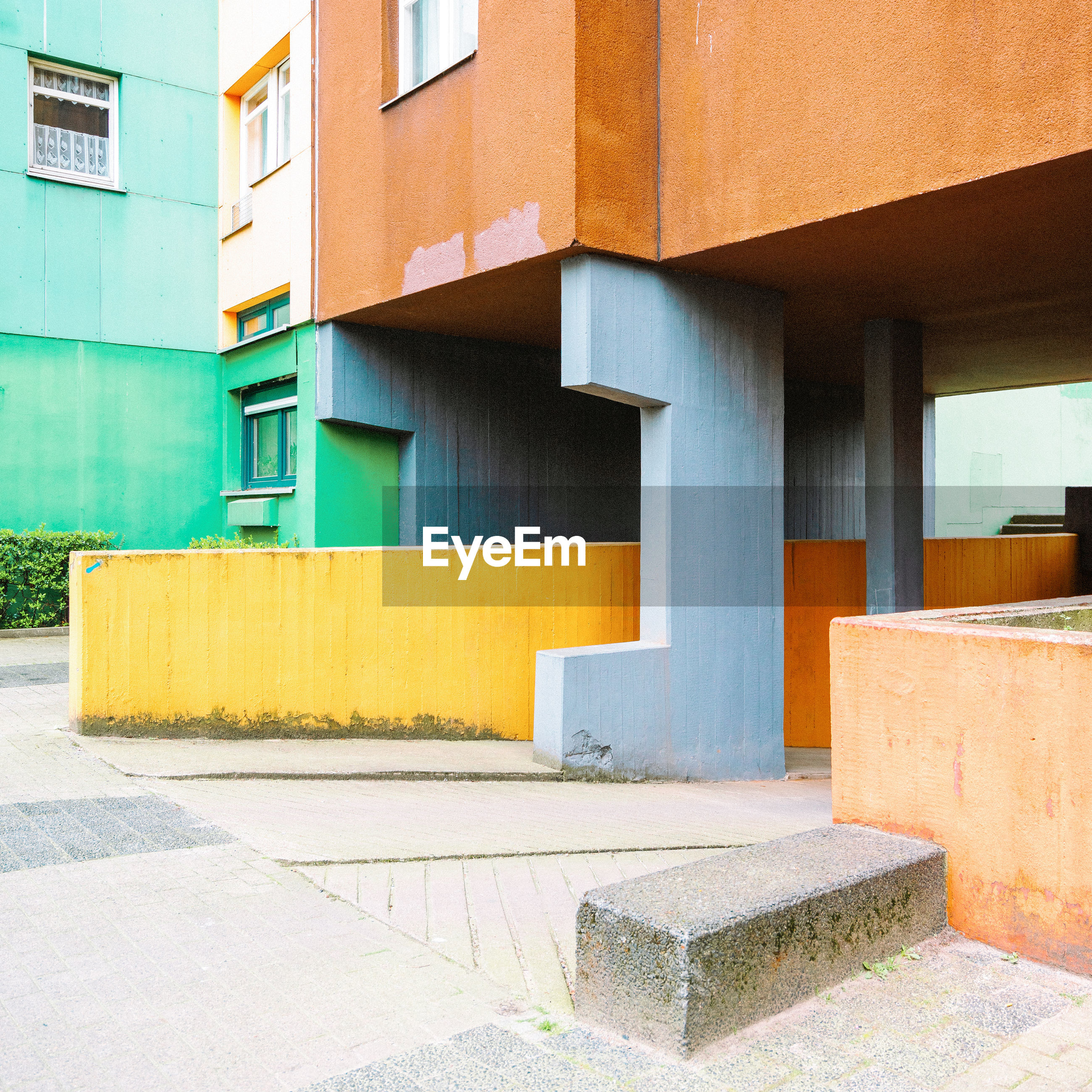 architecture, built structure, building exterior, building, no people, day, city, empty, footpath, outdoors, wall - building feature, modern, staircase, window, nature, multi colored, entrance, concrete, orange color, sunlight