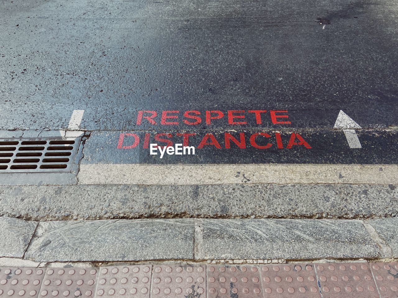 HIGH ANGLE VIEW OF TEXT WRITTEN ON STREET