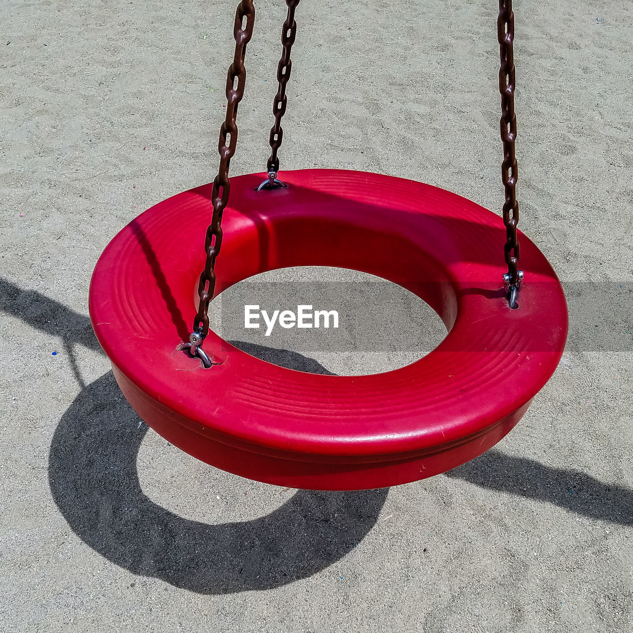 chain, no people, hanging, swing, absence, playground, outdoors, day, red, sand, outdoor play equipment, close-up