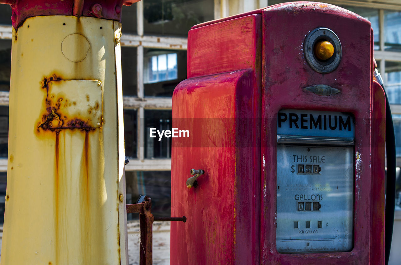 metal, red, close-up, old, no people, rusty, day, telephone booth, abandoned, focus on foreground, text, telephone, fuel pump, communication, technology, refueling, fuel and power generation, safety, connection, outdoors, deterioration, meter - instrument of measurement