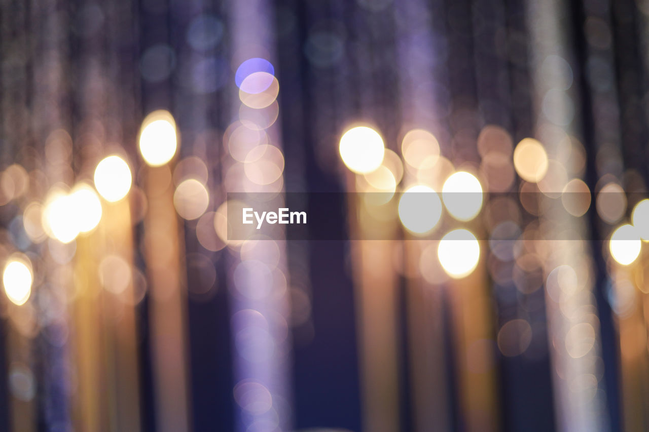 illuminated, defocused, night, light - natural phenomenon, lens flare, no people, glowing, circle, pattern, shape, decoration, lighting equipment, geometric shape, light, multi colored, backgrounds, electric light, christmas, city, design, outdoors, abstract, electrical equipment, nightlife