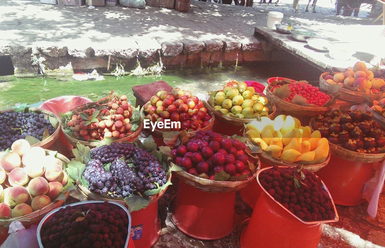 fruit, variation, food, choice, food and drink, healthy eating, market stall, day, for sale, outdoors, freshness, grape, abundance, large group of objects, market, basket, retail, no people